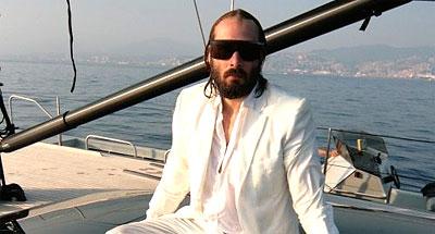 Sebastien Tellier on a boat.