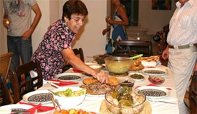 Alex's aunt sets the table for a Cypriot family dinner.