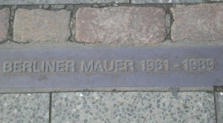 A plaque marks the site of the former Berlin Wall.