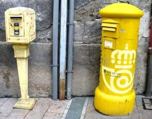 French and Spanish mailboxes side by side.