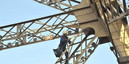 Repainting the Eiffel Tower. Photo by Theodora Brack.