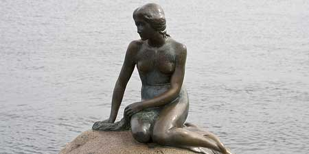 The Little Mermaid statue at the Copenhagen Harbor. Photo by StePagna.
