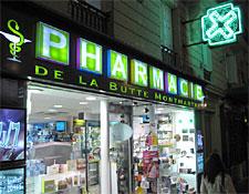 The green cross marks a Paris pharmacy.