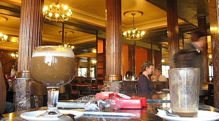 Passing the afternoon in Madrid's historic Café Commercial. Photo: Tnarik