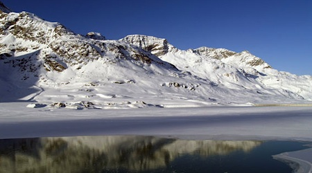 The view of Lago Bianco near the summit of the Bernina Pass. Photo © hidden europe