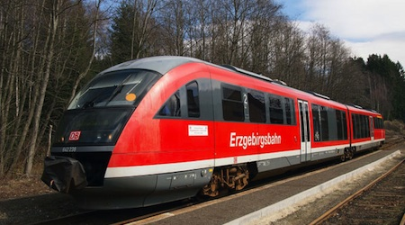 An Erzgebirgsbahn train pauses as the Czech village of Potucky. Photo © hidden europe