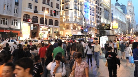 Look like a local as you stroll Madrid's Gran Via. Photo: Tom Meyers