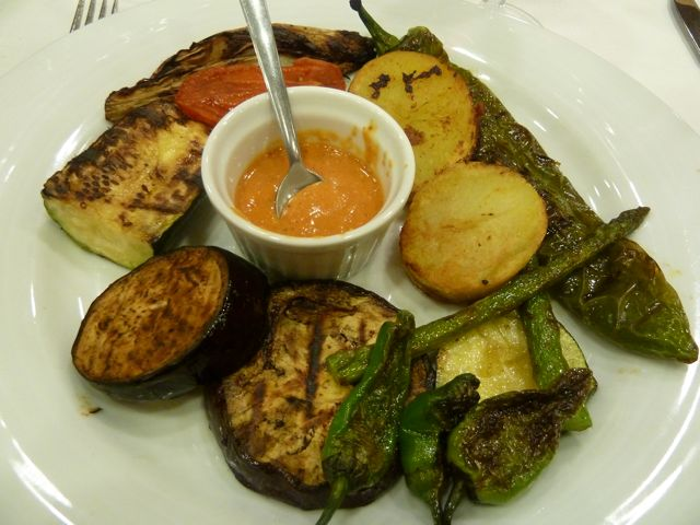 Eating Roasted Vegetables with Romesco Sauce in Barcelona, Spain