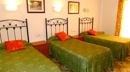 A simple but pleasant triple room for a great value at Hostal Ramos. Photo: EuroCheapo