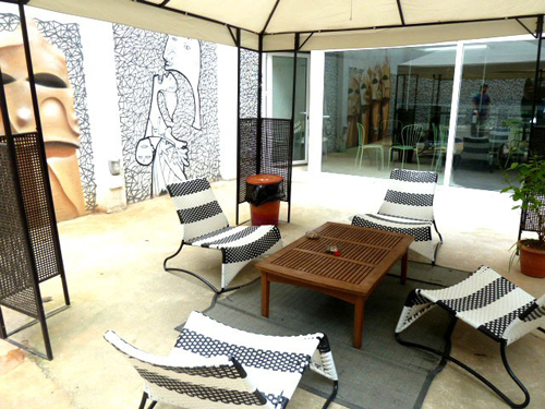 The sun-drenched terrace with comfy outdoor furniture at Hotel One Paralelo. Photo: EuroCheapo