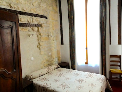 Rooms at the St. Andre des Arts have old stone walls.