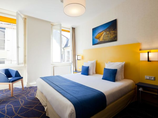 blue and yellow hotel room