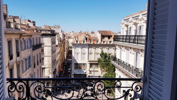 view of Marseille from wrought iron balcony
