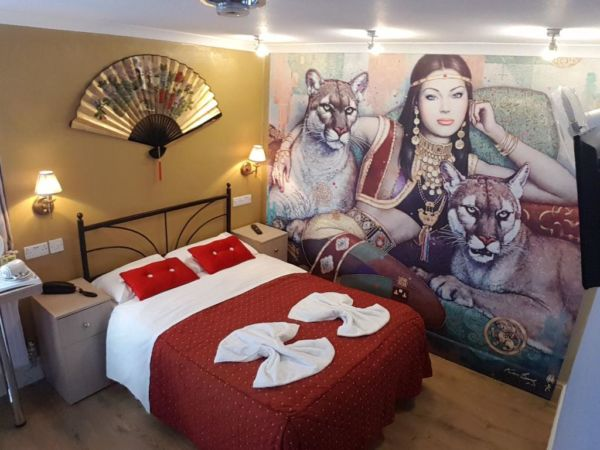 hotel room with large  wall mural