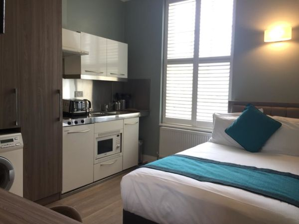 hotel room with kitchenette
